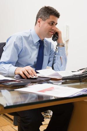 Estate agent on the phone Stok Fotoğraf