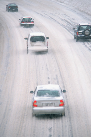 Cars driving on snowy motorway