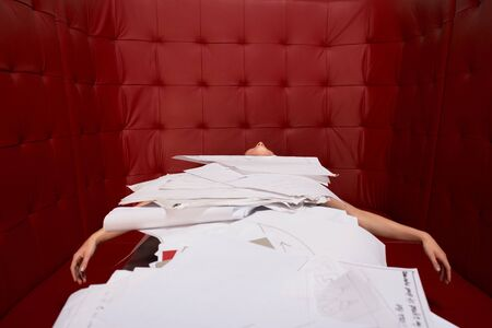 Businesswoman lying on table