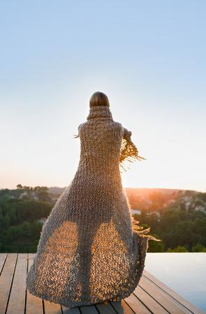 Woman standing on terrace back view Stok Fotoğraf