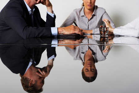 Three business peoples reflection Imagens