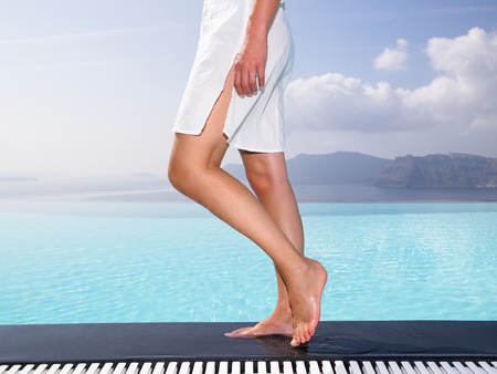Womans legs on the edge of a pool