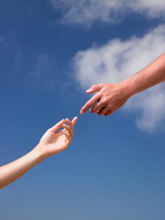 Dos manos, casi tocándose Foto de archivo