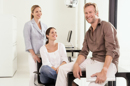 Man and two women in office Stock Photo