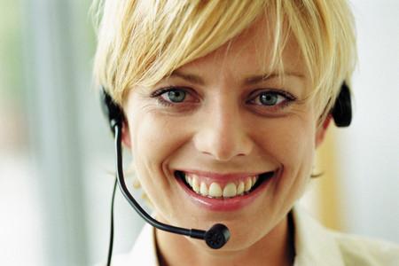 Smiling female telephonist