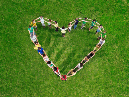 Group in heart shape formation Фото со стока