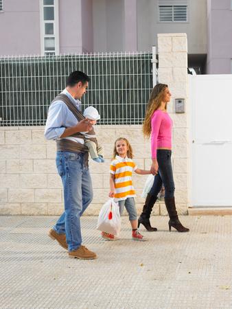Family walking on pavement