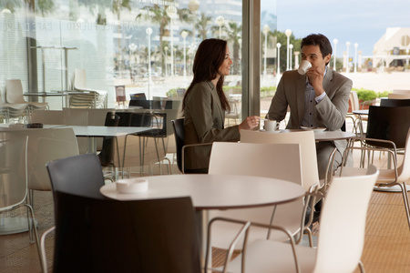 Businessman and businesswoman at caf�