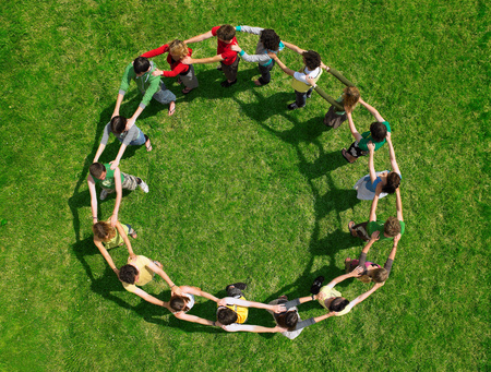 Group standing joined in a circle