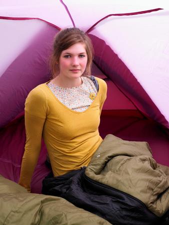 Girl sitting in sleeping bag