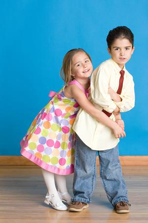 Girl trying to hug boy