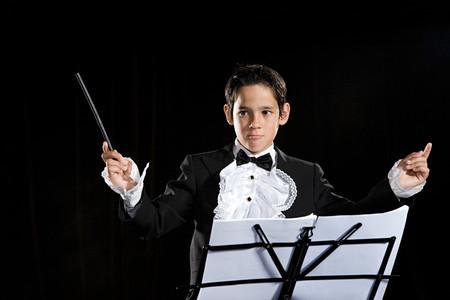 Een jongen die zich voordoet als componist Stockfoto