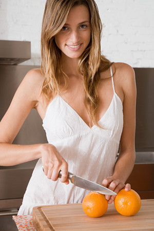 A woman slicing oranges