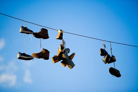 Shoes hanging from power line