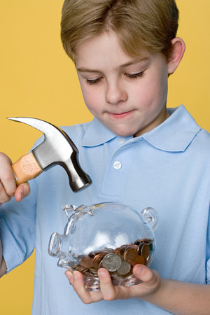 Boy with hammer and piggy bank