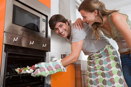 A couple cooking food Stock Photo