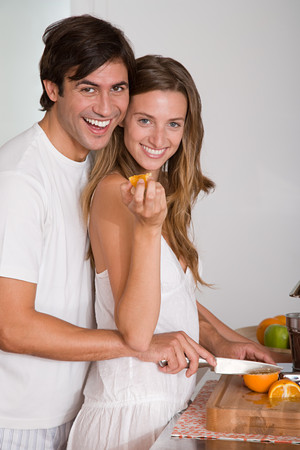 A couple slicing oranges Stock Photo