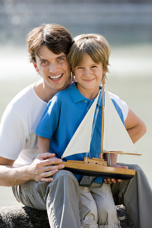 Father and son with toy boat 版權商用圖片