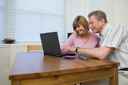 Couple using laptop Stock Photo