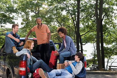 Friends in pickup truck