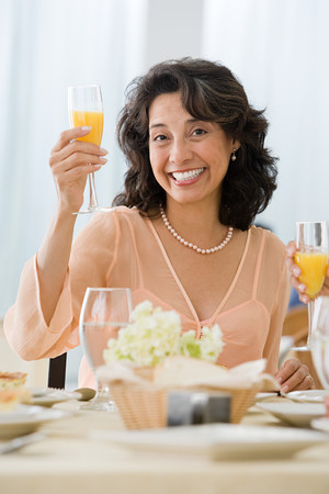 Woman holding drink Stock Photo