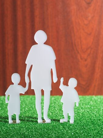 Model family in cut out paper