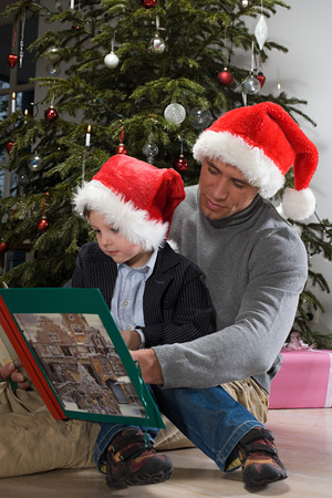 A father and son reading a book