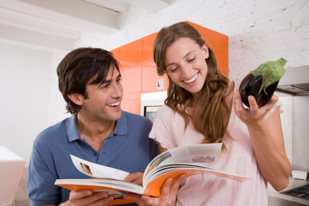 A couple reading a cookbook Stock Photo