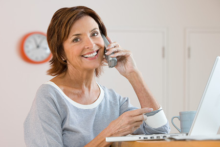 A woman telephone banking Stock Photo