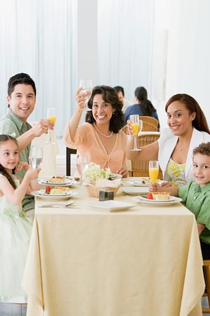 Family toasting Фото со стока