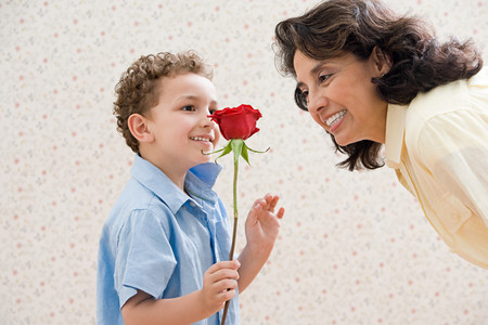 Boy with rose for grandmother