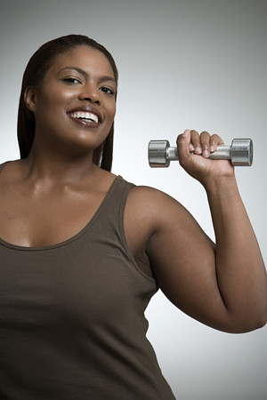 Woman with dumbbell Banco de Imagens - 124928716