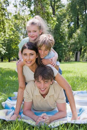 Family in the park Banco de Imagens - 124928729