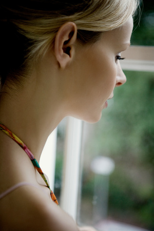 Woman looking out of window.