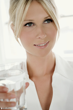 Woman with glass of water. Imagens