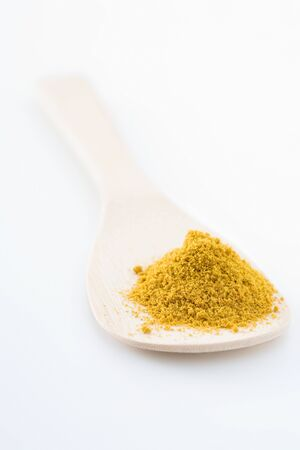 Curry powder and a wooden spoon