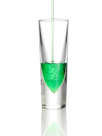 Green drink pouring into glass