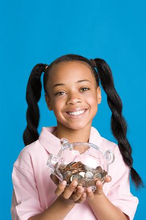 Girl with a piggy bank Banco de Imagens