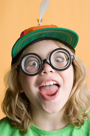 Girl wearing silly glasses and hat Imagens