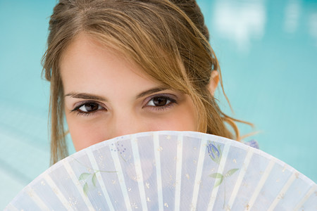 Young woman with fan