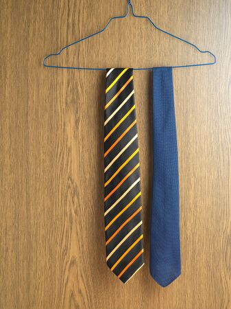 Two ties hanging on a coat hanger