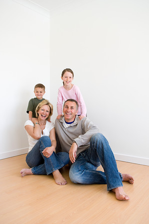 Family sitting on the floor Stock Photo