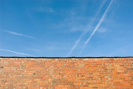 Brick wall and the blue sky