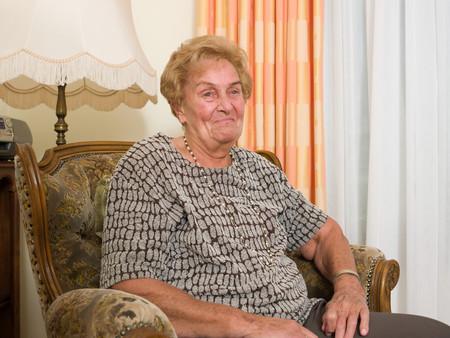 Senior woman sitting in an armchair