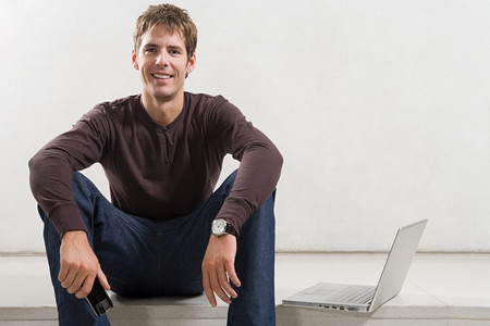 Portrait of a man with a laptop Stock Photo