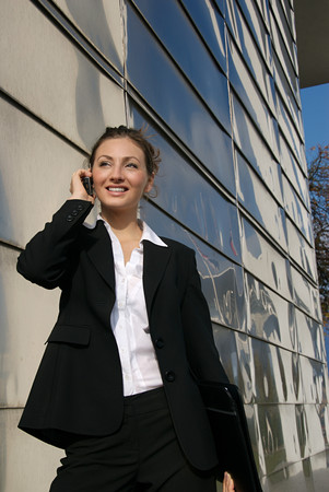 Businesswoman using a cell phone Stock Photo