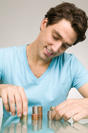 Man stacking coins