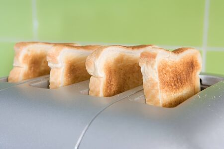 Toast in a toaster Stock Photo
