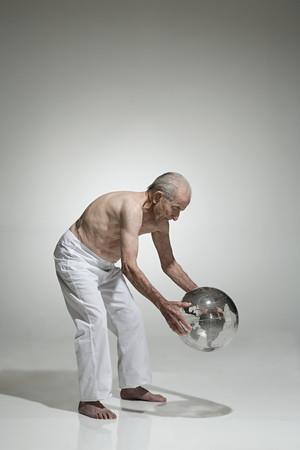Senior man holding a globe