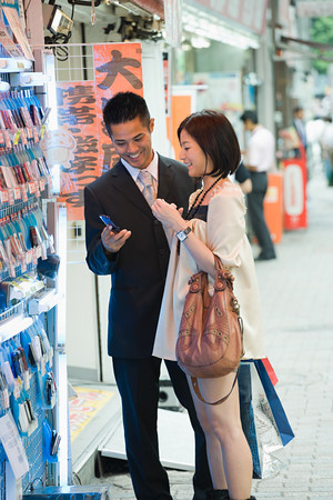 A couple shopping for cell phones